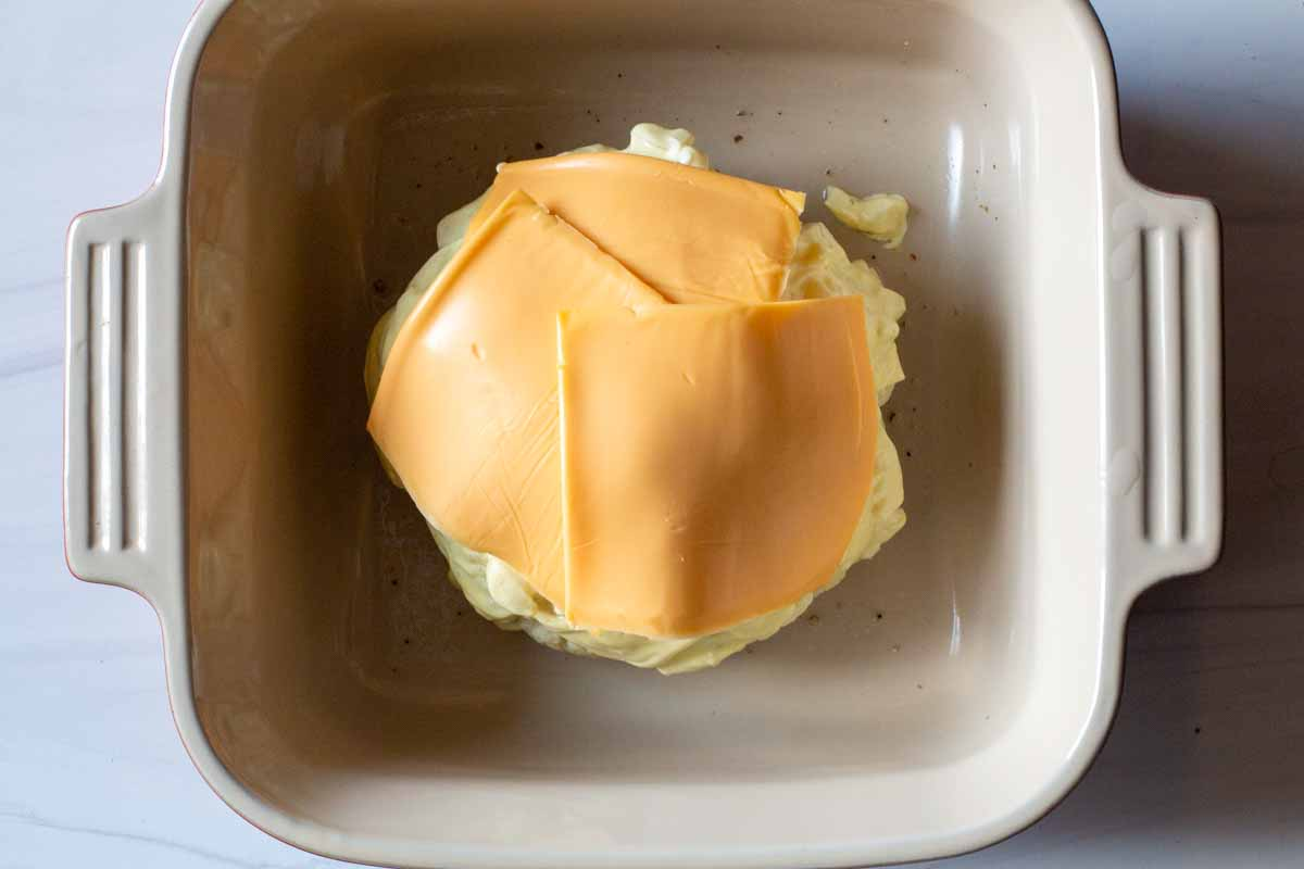 Adding american cheese slices to microwave cauliflower