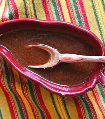 Best homemade enchilada sauce in a chile pepper shaped bowl.