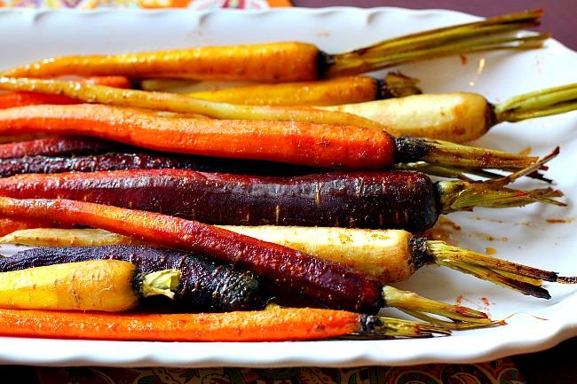 Oven glazed carrots on a white platter