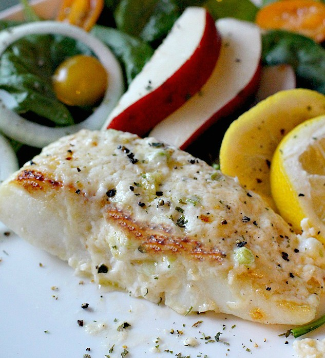 Broiled halibut fillets with mayo parmesan cheese topping with pear salad