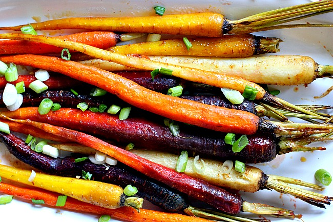 Oven roasted glazed carrots topped with sliced green onions