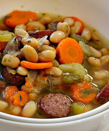 White beans and sausage soup made in the instant pot with carrots, celery and onion.