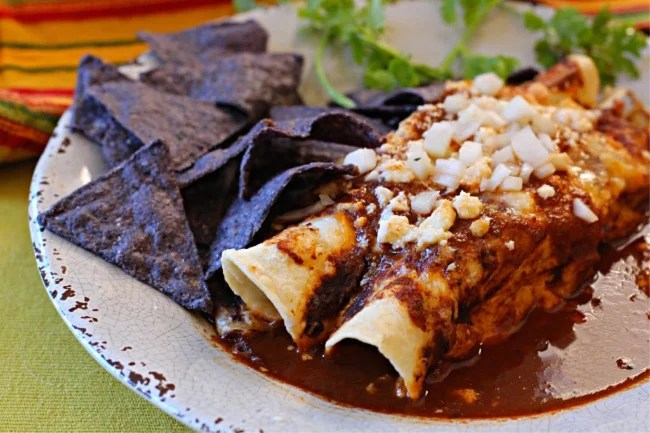 Beef and bean burrito smothered in enchilada sauce