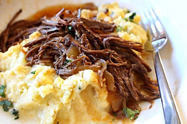 Beef brisket cooked in cola and bbq sauce and served over mashed potatoes