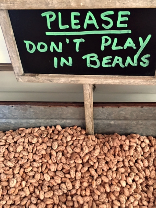 Please don't play in beans sign in dried beans