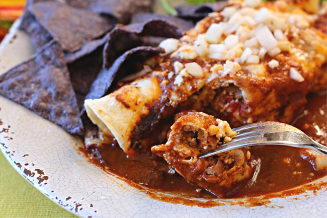 Easy beef and bean burrito smothered in enchilada sauce