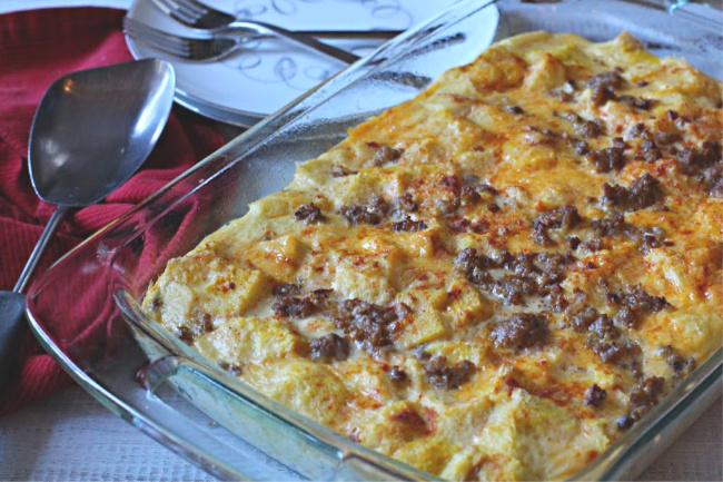 Sausage egg cheese casserole in a 9 x 13 pyrex casserole dish
