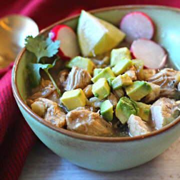 Pork Posole Recipe in the Instant Pot Pressure Cooker served in a green Frankoma soup bowl.