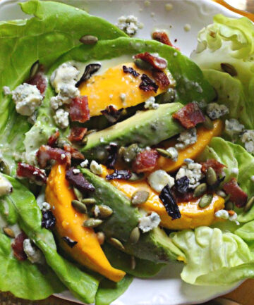 Bibb lettuce avocado mango salad with bacon and pepita seeds