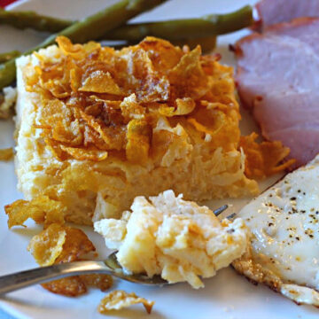 Cheesy potatoes with corn flakes. With a fried egg