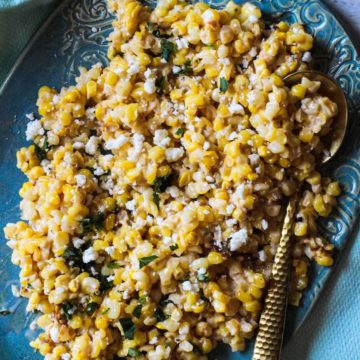 Mexican corn salad recipe served on a turquoise platter