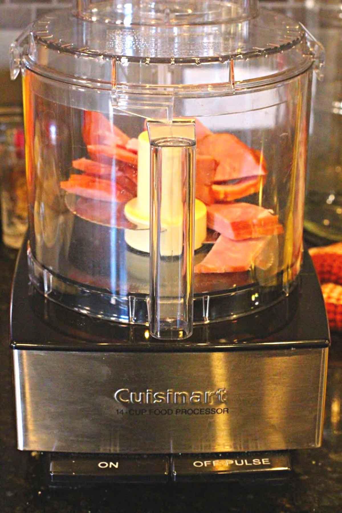 chopping ham in a food processor to make ham salad sandwiches
