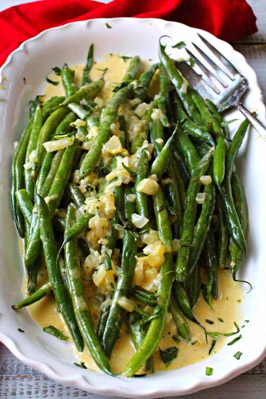 Hericot vert recipe topped with shallots and cooked in a dijon mustard sauce