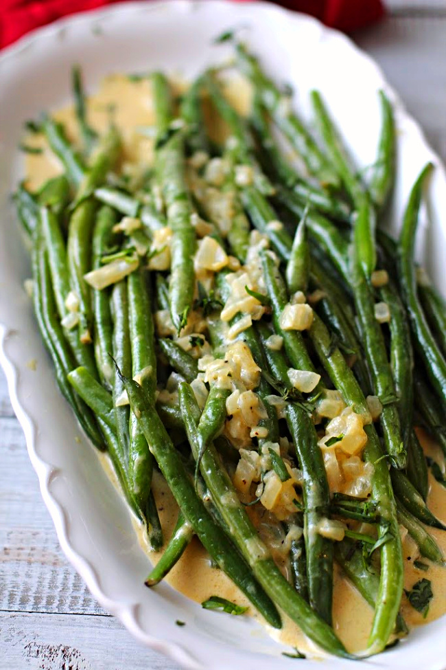 Green beans in a French Mustard Sauce on a Sur la Table White scalloped platter
