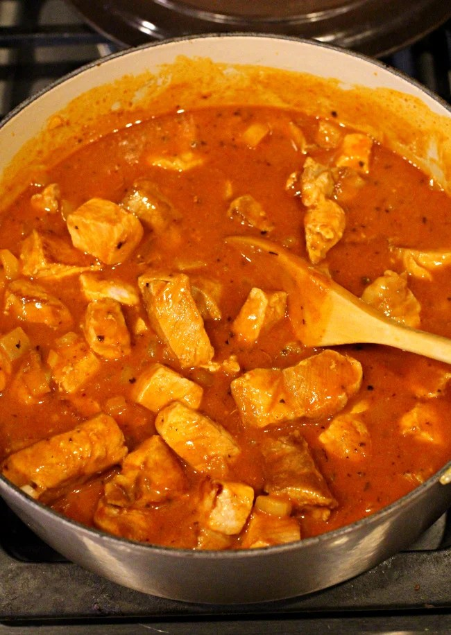 Pork loin roast marinating in New Mexico Red Chile Sauce
