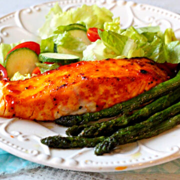 Farm raised salmon fillets baked with a peach jam glaze with a side of sauteed asparagus and a tossed salad