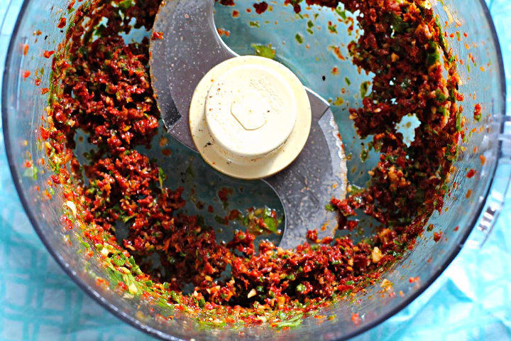 Sun-dried tomato basil spread for stuffed brie appetizer
