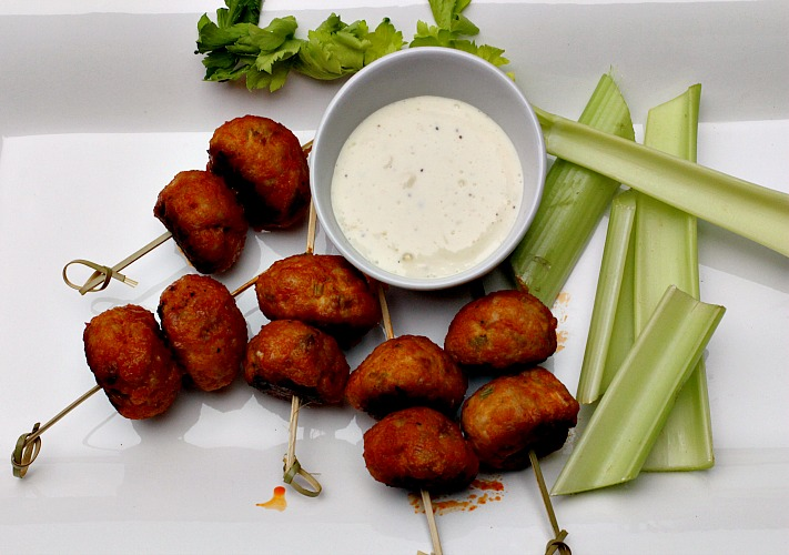 Chicken meatballs glazed in buffalo wing sauce served with blue cheese dressing and celery sticks.