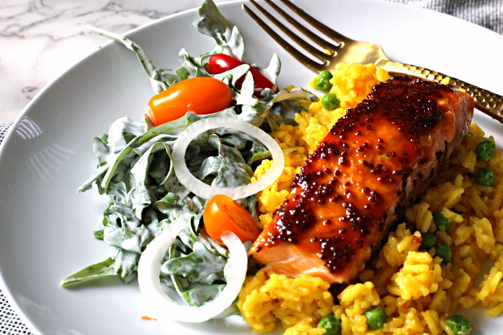 Salmon fillet glazed with maple and mustard served over Yellow rice with peas and a side salad tossed with buttermilk ranch dressing