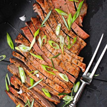 Grilled flank steak topped with sliced green onions