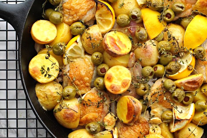 Cast Iron Skillet Chicken thighs with lemon, yukon gold potatoes, thyme, and olives.