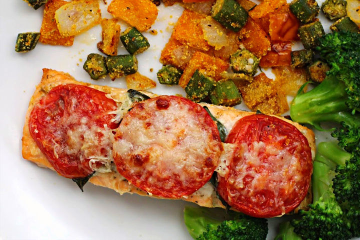 Roasted salmon fillets topped with basil leaves, sliced tomatoes and parmesan cheese. Served with broccoli, okra and yellow bell pepper