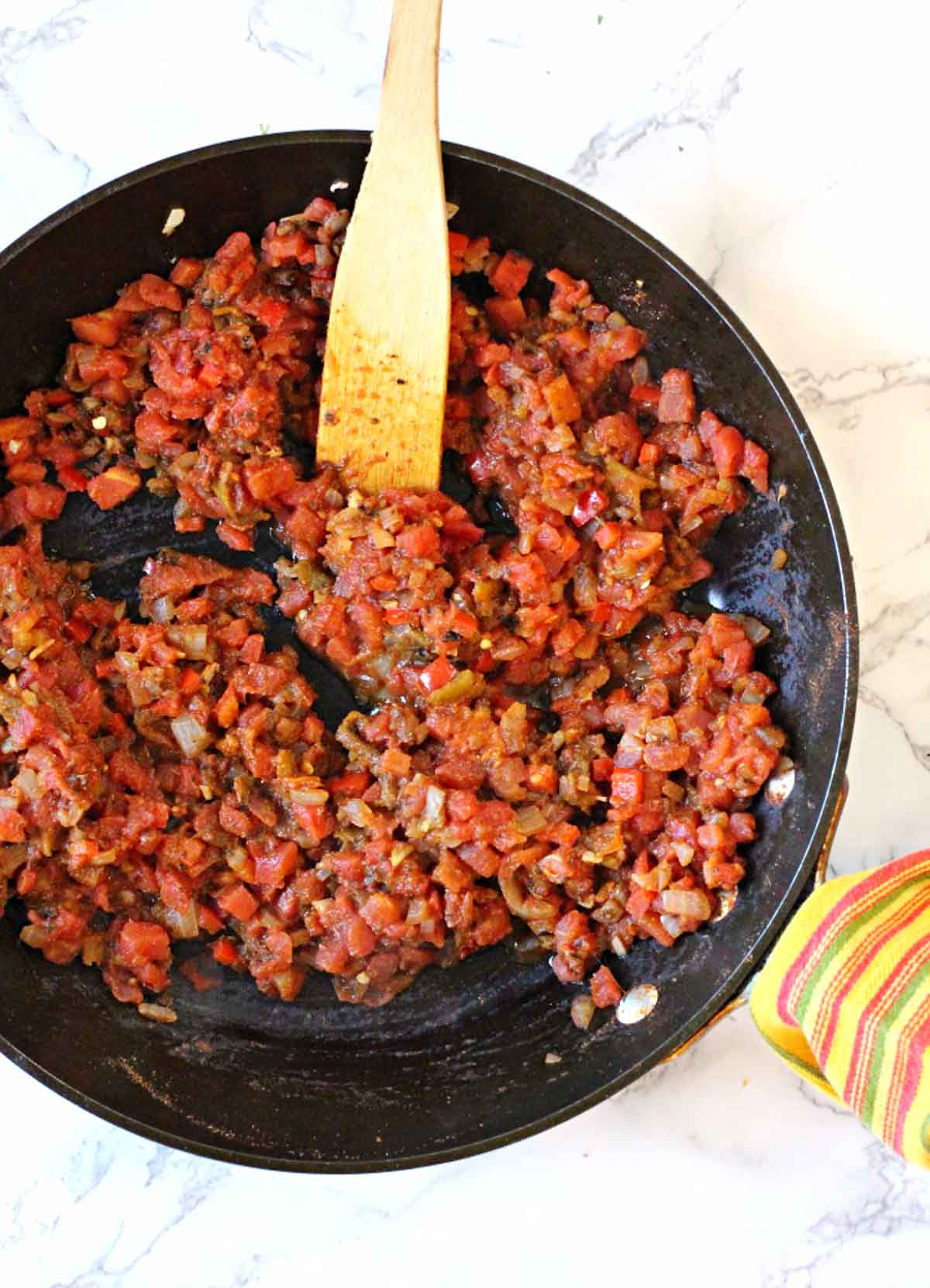 Making sofrito for spicy meatloaf in a fry pan