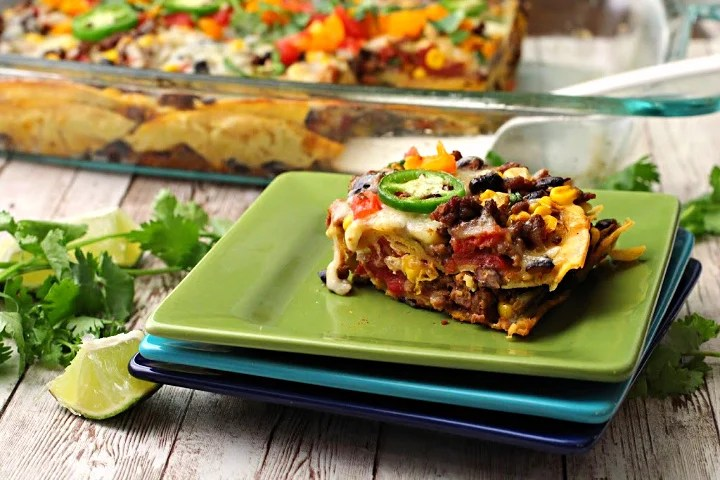 Mexican casserole made with ground beef, corn tortillas, sour cream, pepper jack cheese, sweet corn, black beans and canned tomatoes. Topped with fresh tomatoes, cilantro and jalapeno. Served on Mexican colored appetizer plates