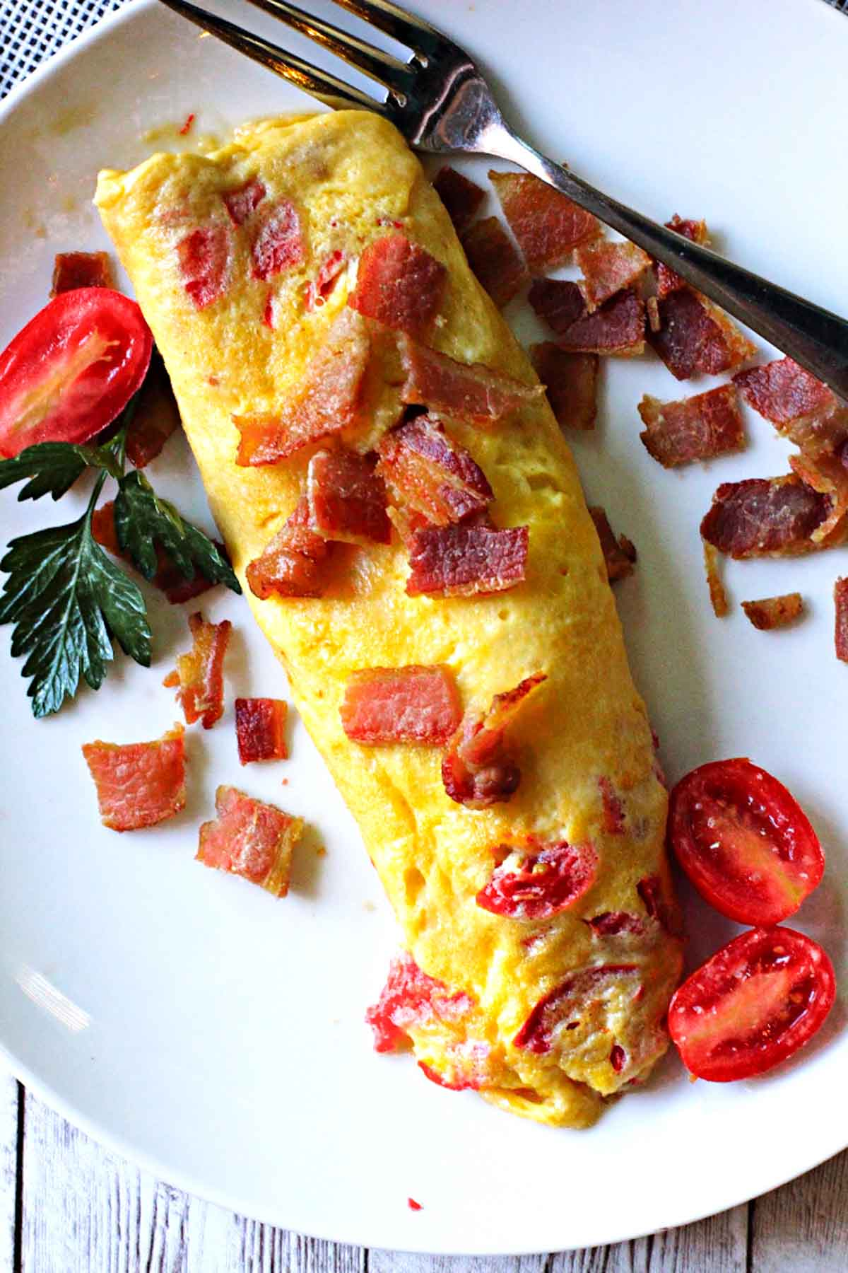 2-egg Omelette topped with bacon and garnished with cherry tomatoes