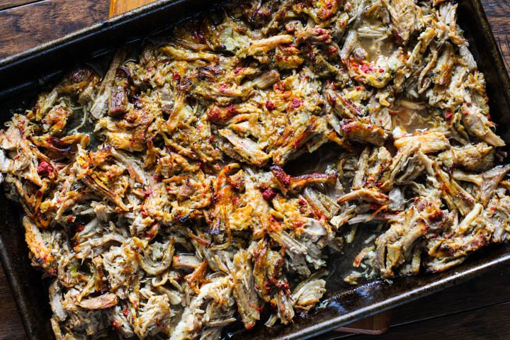 Instant Pot Canitas Recipe. Shredded pork on a sheet pan ready to broil in the oven to make the pork crispy