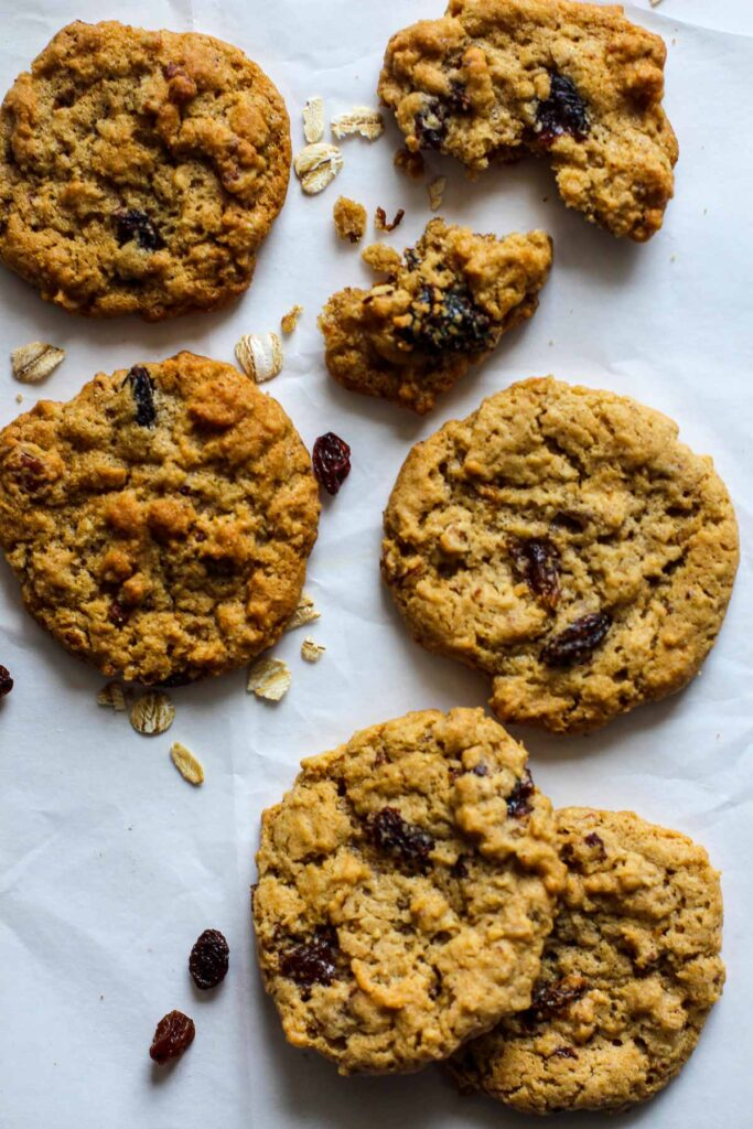 Oatmeal Cookies with raisins and pecans on parchment paper.