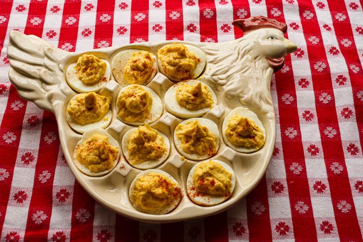 White Chicken Deviled Eggs platter on a red white checked tablecloth