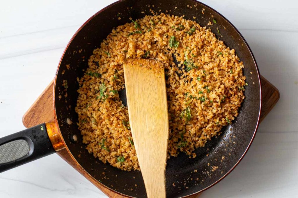 toasting panko bread crumbs with chile powder and cilantro