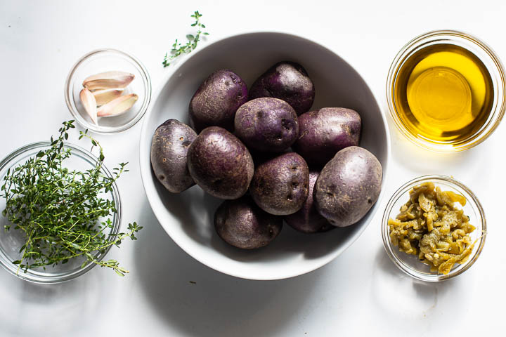 Ingredients for purple potatoes roasted with garlic and chile peppers
