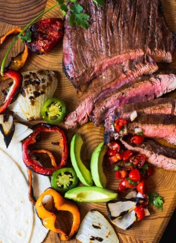 Flank Steak Fajitas with grilled vegetables, avocados and flour tortillas