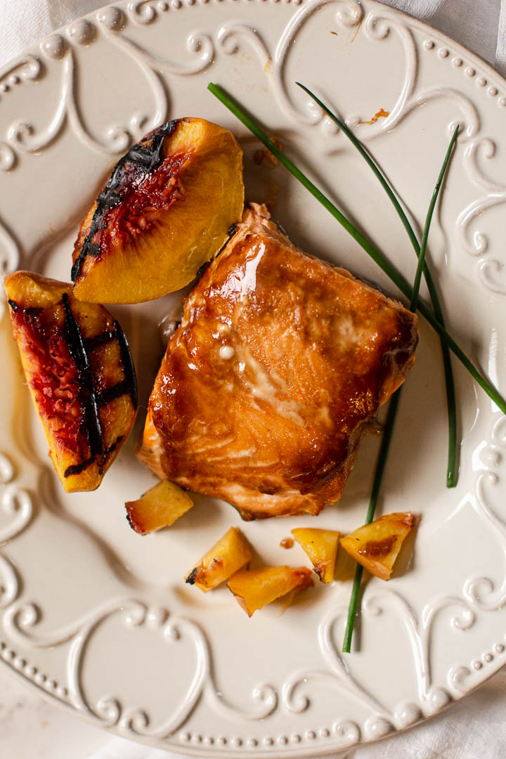 Salmon filet glazed with Teriyaki auce with grilled peaches and chives