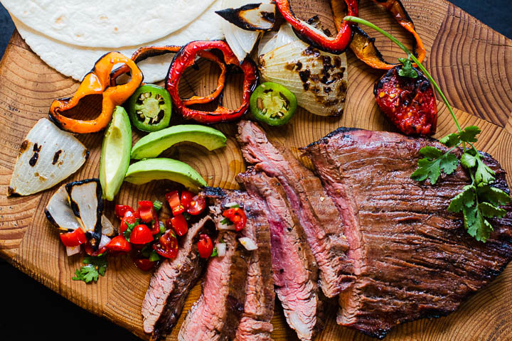 Flank steak fajitas with grilled vegetables and flour tortillas