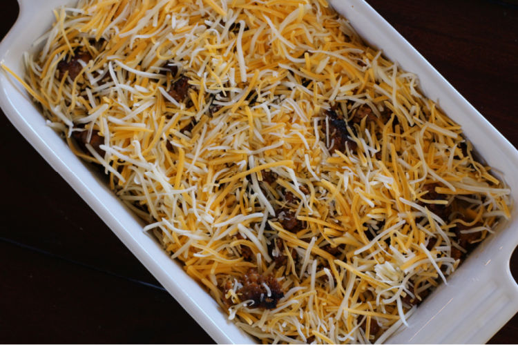 Adding shredded cheese to breakfast casserole