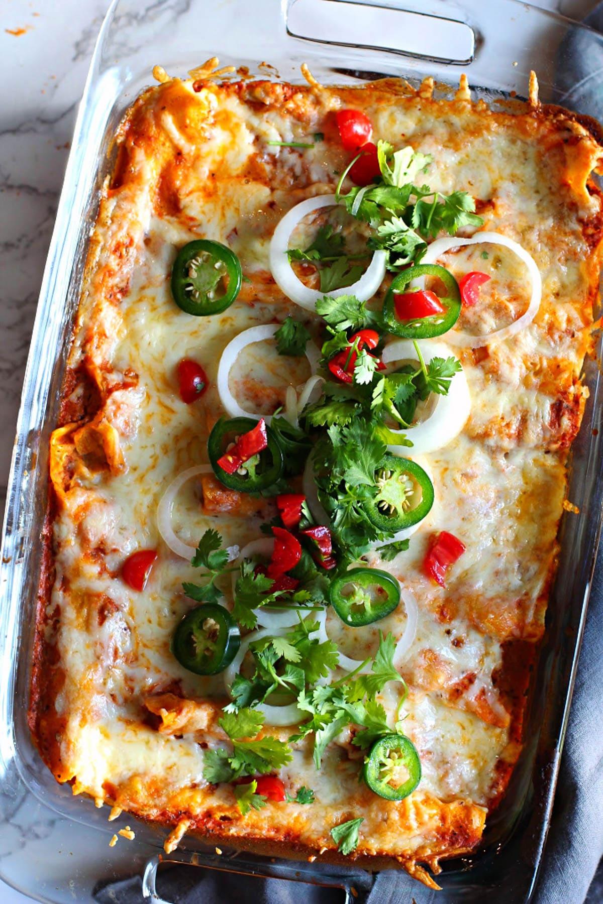 Chicken enchilada casserole with tomato cream sauce