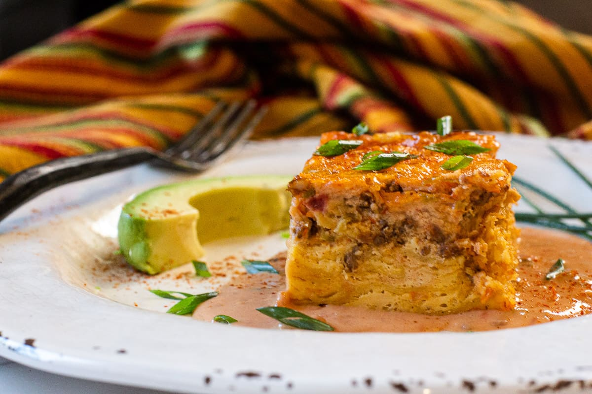 Mexican Breakfast Casserole with chorizo and corn tortillas with velveeta cheese sauce