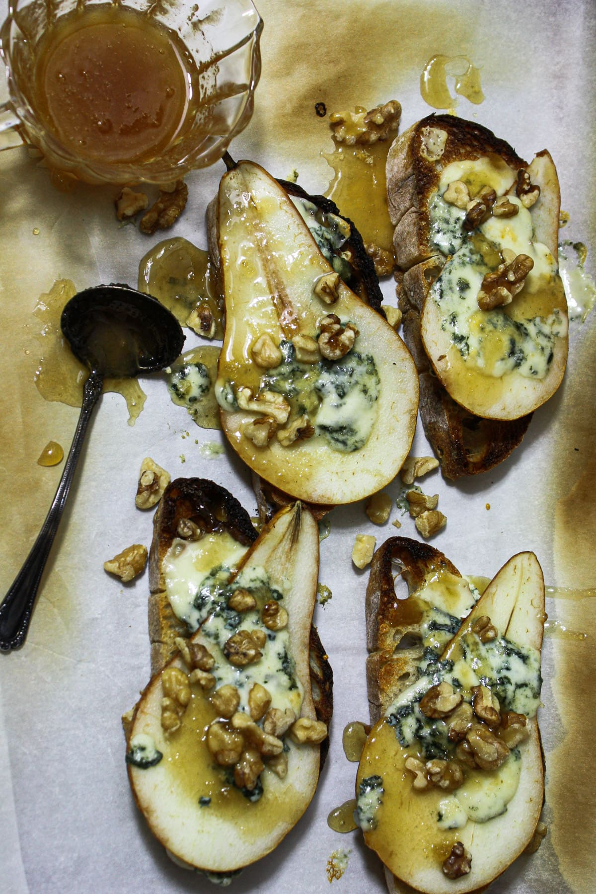 Toasted crostini topped with pear, blue cheese walnuts and honey.