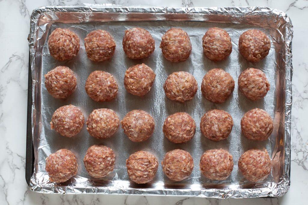 Italian meatballs ready to bake for Sriracha Meatballs appetizer
