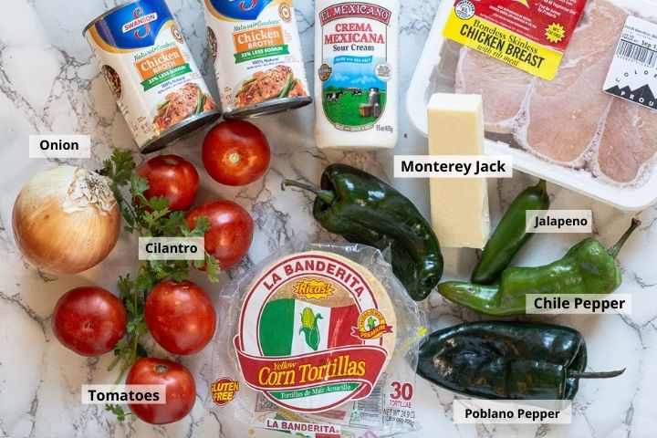Ingredients for baked chicken enchiladas with tomato cream sauce.