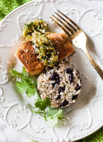Mexican salmon topped with salsa verde with a side of black beans and rice