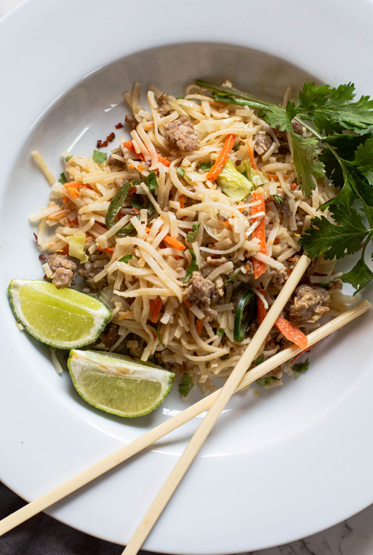 Pad Thai Noodles in a Thai peanut sauce with cabbage and carrots and ground pork