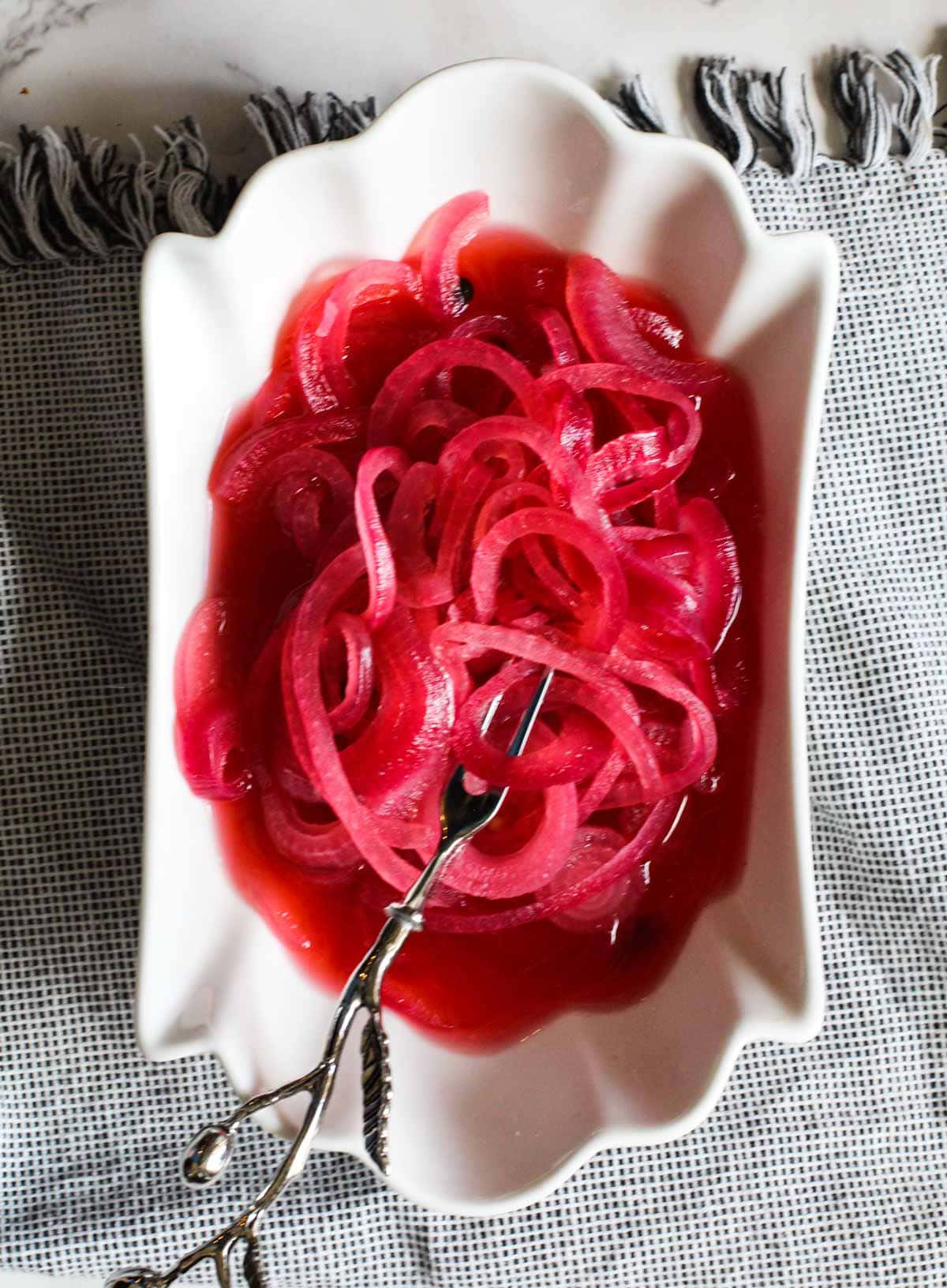 Mexican Pickled Red Onions in a white serving bowl.