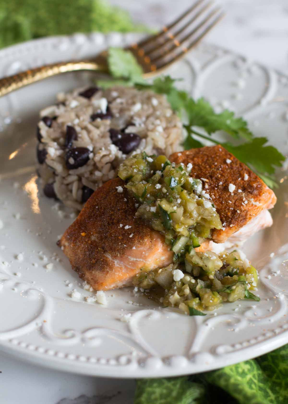 Salmon fillet roasted with Mexican spices and served with black beans and rice.