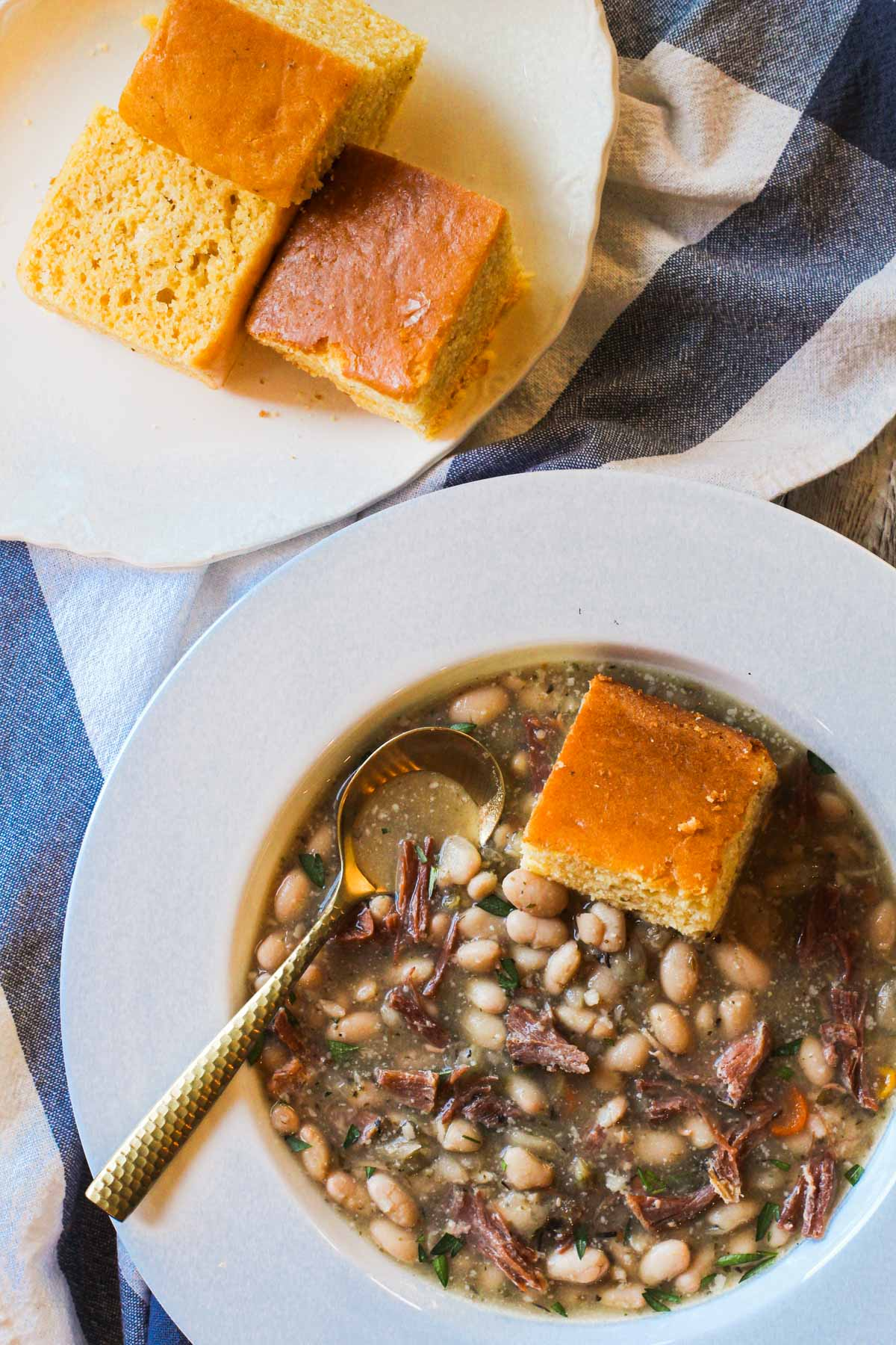 Ham and Bean made with ham shank and great northern beans served with pieces of corn bread