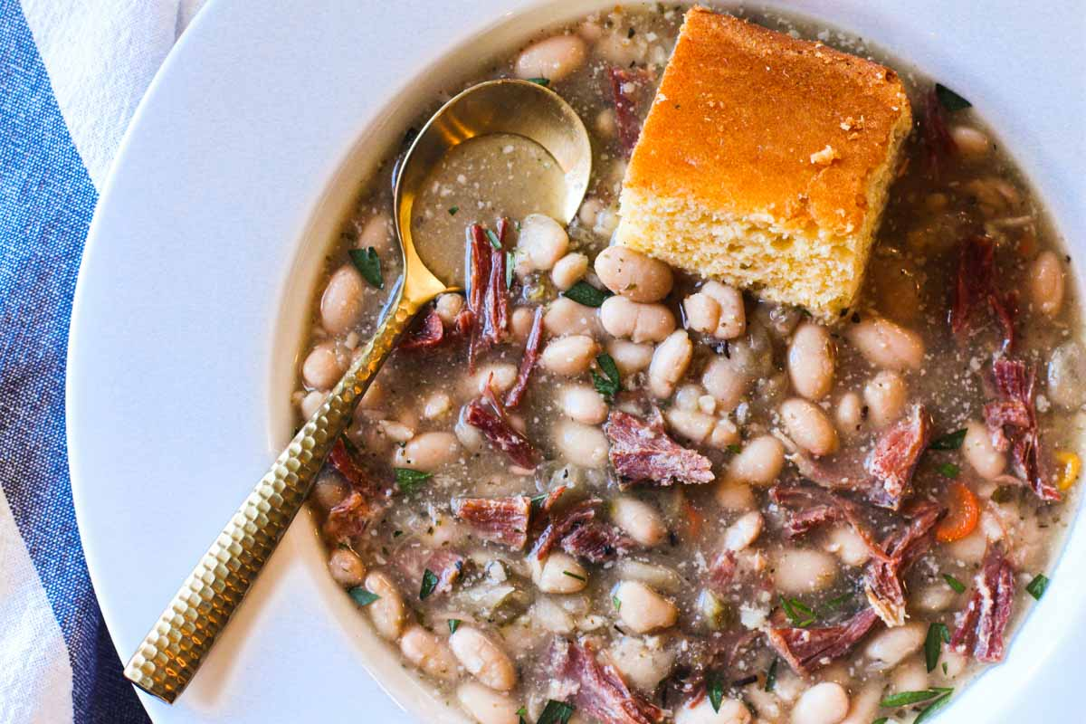Crock Pot Ham and Beans served with cornbread.
