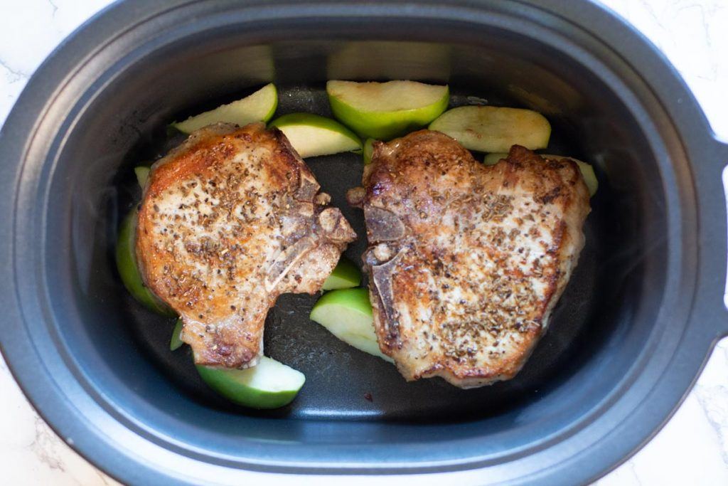 Adding thick cut bone in pork chops to crockpot over apples